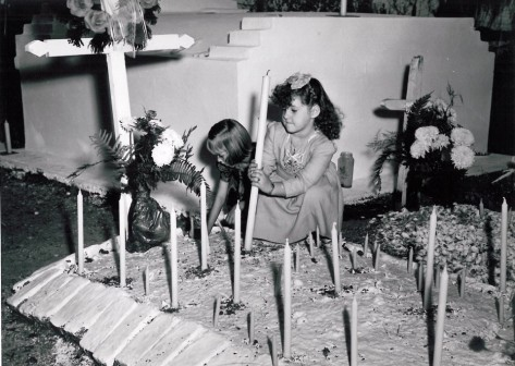 bserving All Saints' Day in Bayou Barataria, just below New Orleans, children place candles on a family grave. The plot on the right, marked by oyster shells, is said to be the resting place of Pirate Jean Lafitte. November 1, 1946. (ACME Telefoto/The Times-Picayune archive)