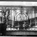 early 20th century photo of the 3rd story monogram from the balcony side.